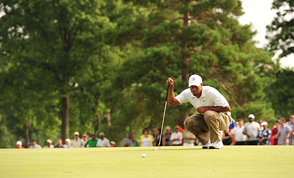 After 27 putts in the first round, Woods struggled with his putter for much of Friday.