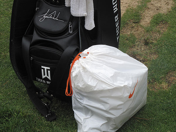 Woods, like other players, received a large bag of goodies from his sponsor. This Nike bag likely contained things like golf gloves, balls, commemorative shoes and other gifts for Tiger.