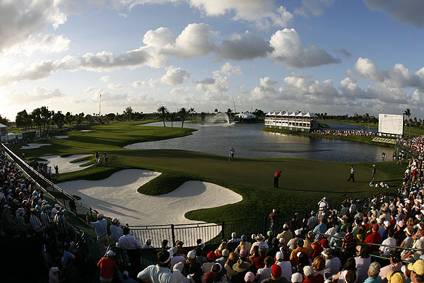 """I again used the 15mm full-frame fisheye lens to capture the entire green and fairway as Woods putted on the 18th at Doral."""