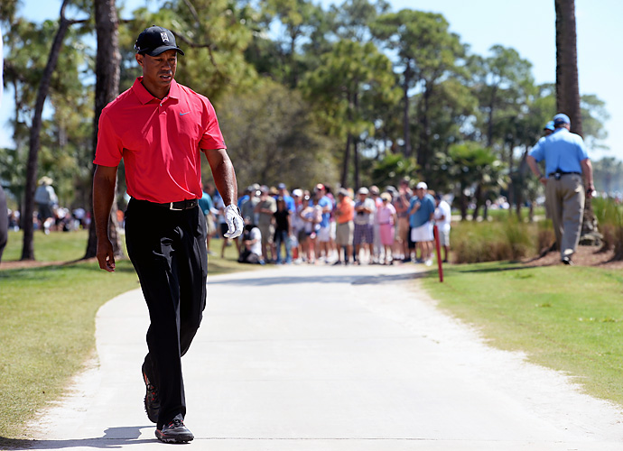 Woods walked off the course after 13 holes, citing a lower back injury and back spasms.