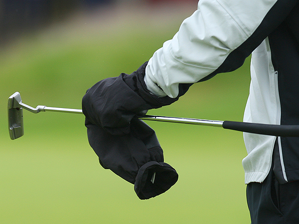 Woods put on gloves after making a par putt on No. 4 to stay at one under. He wore gloves between shots for most of his round.