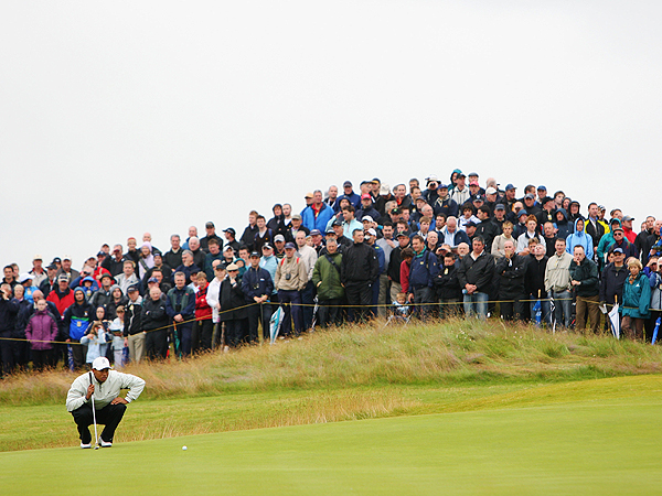 After escaping the sand, Woods was left with a lengthy putt for par. He missed it and dropped to two under.