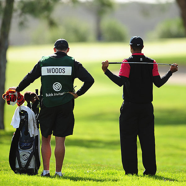 Woods with his caddie, Steve Williams, in a leisurely moment between shots on Sunday.