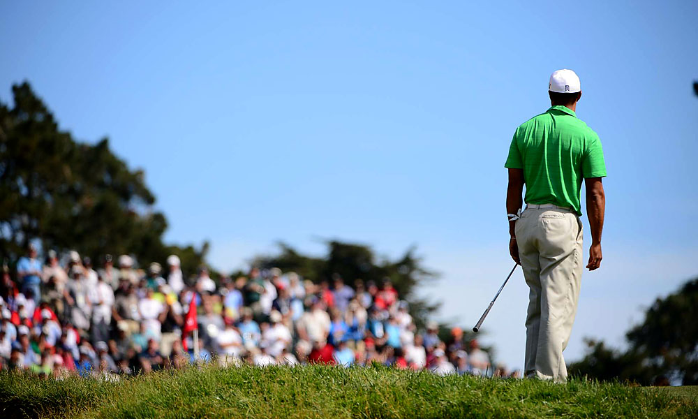 Woods finally made his first birdie on the ninth hole.