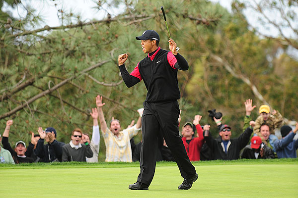 Woods holed a bomb for birdie in the final round on the par-3 11th hole, and he went on to win his fourth consecutive Buick Invitational by eight shots.