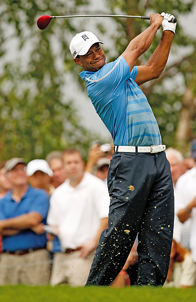 Thursday                       Tiger Woods started off strong in the first round at Liberty National. Players had to battle a 2 1/2 hour rain delay in the morning and a second long delay in the afternoon.