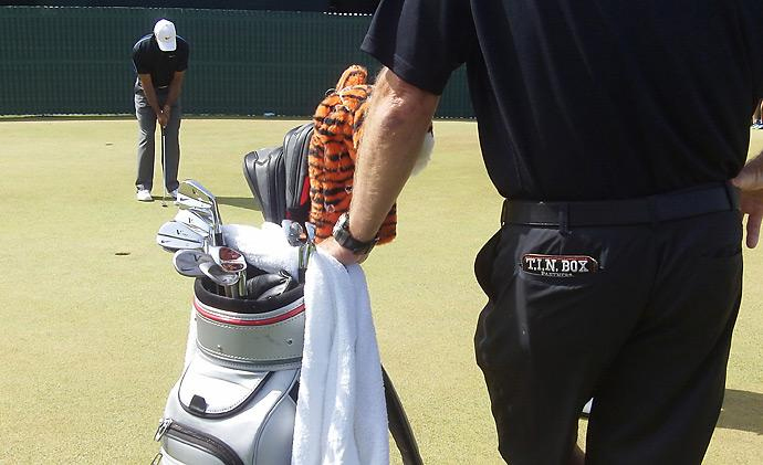Caddie Joe LaCava guarded Tiger Woods' bag at the British Open while his boss putted on the practice green.