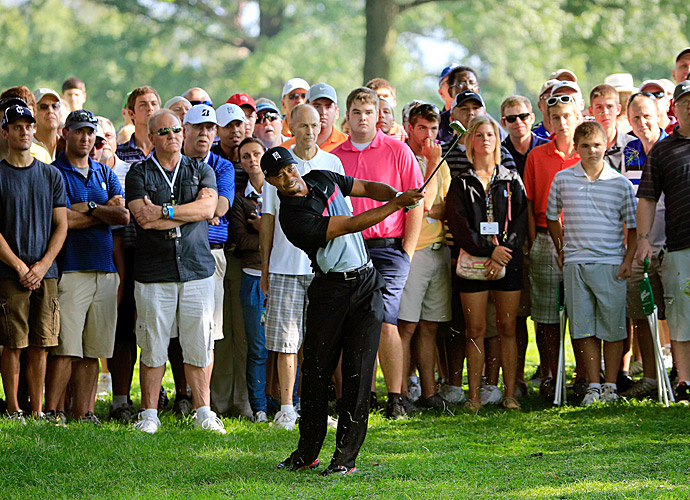 Woods is trying to win for the eighth time at Firestone Country Club.