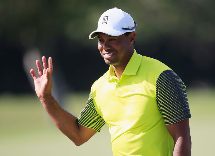 Tiger Woods acknowledges the crowd after rolling in a 91-foot birdie putt on the fourth hole.