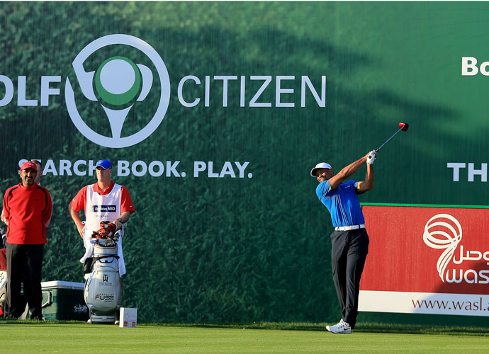 Tiger Woods follows through during the pro-am in Dubai.