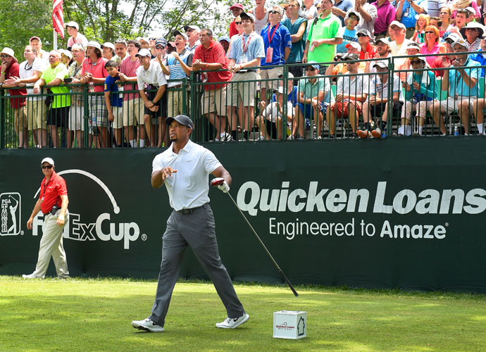 """Tiger Woods tracks his drive on the first hole of the second round. """"The one thing I was worried about most was going out there and hitting driver full out,"""" he said."""