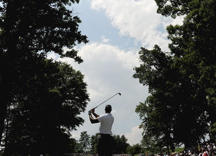 Tiger Woods watches his tee shot on the seventh hole. The missed cut was his first 36-hole missed cut since the 2012 Greenbrier Classic.
