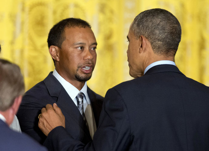 President Barack Obama greets Tiger Woods. The two played a round earlier this month at the Floridian.
