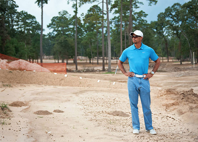 The 'Mom Jeans' mean business as Tiger visits the site of his new golf course, Bluejack National, in Montgomery, Texas, in October 2013.