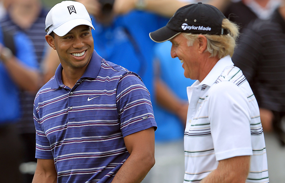 Woods shared a laugh with Presidents Cup International team captain Greg Norman.