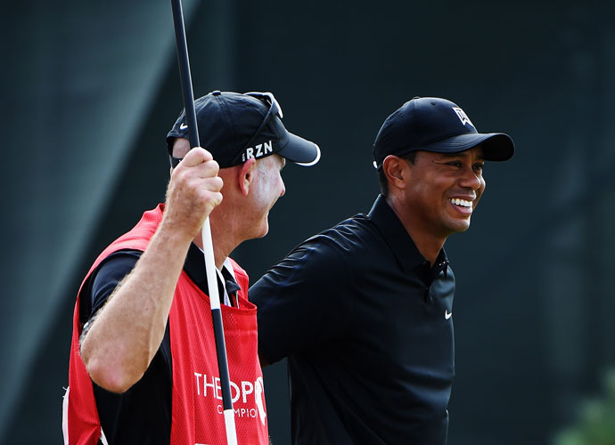 Tiger Woods laughs with caddie Joe La Cava during the second round.