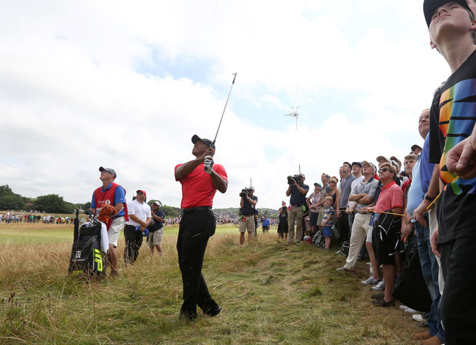 Tiger Woods plays a shot along the 12th fairway during his final-round 75. He finished the tournament +6.