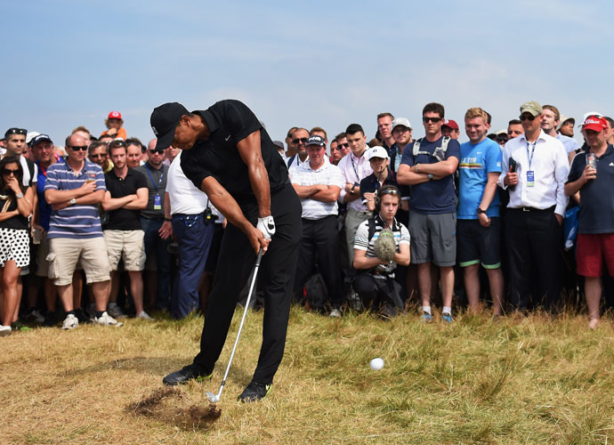 Tiger Woods watches the flight of a tee shot. He's playing in his first major this year after missing the Masters and U.S. Open to recuperate from back surgery.