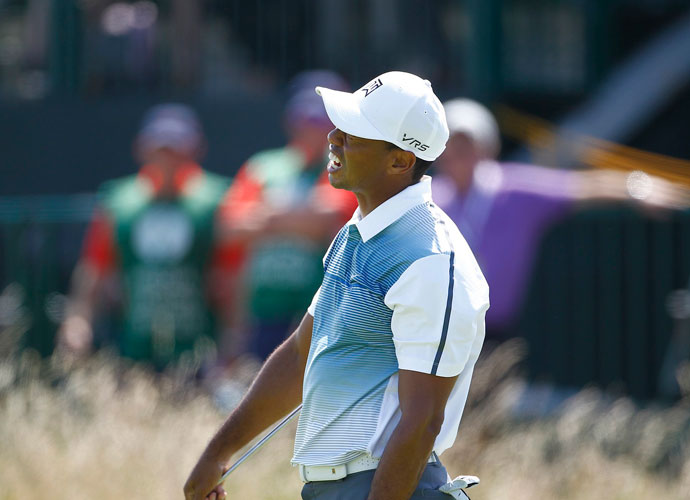 """Tiger Woods reacts to a missed putt early in his first round. """"You look at the scores, there's a ton of players between two and four under par. And that's kind of the way this championship, I think, is going to unfold,"""" he said."""