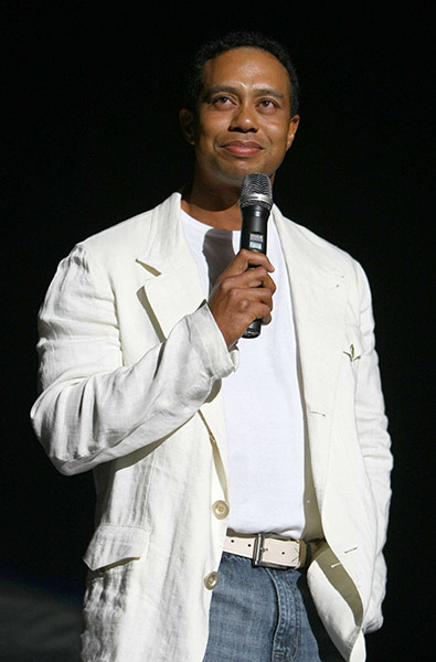 Tiger Woods hosts the 12th Annual Tiger Jam (2009) in this white linen, white belt and high baggy jeans ensemble.
