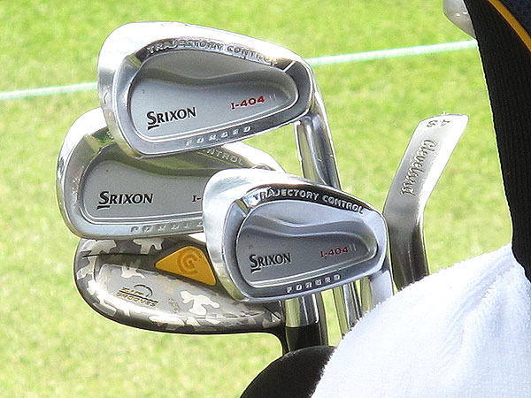 relies on Srixon I-404 irons and unique Cleveland CG14 wedges with a camouflage finish.