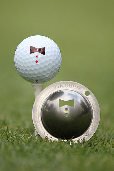 The Tin Cup Ball Marker                             $30, tin-cup.com                             This clever little device allows you to mark your ball, using a Sharpie-type pen, with dozens of designs to choose from, including college emblems and custom options ($12.95 to $19.95). For December, the makers offer a special Christmas package: a Tin Cup of your choice, two pens of your choice, a leather pouch and a black belt clip.