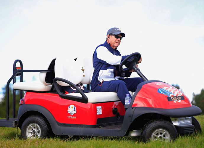 Team USA captain Tom Watson cruises the course in a golf cart.