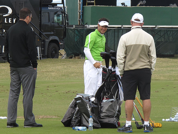 was all smiles after getting a few bags of Nike schwag on the driving range at St. Andrews.
