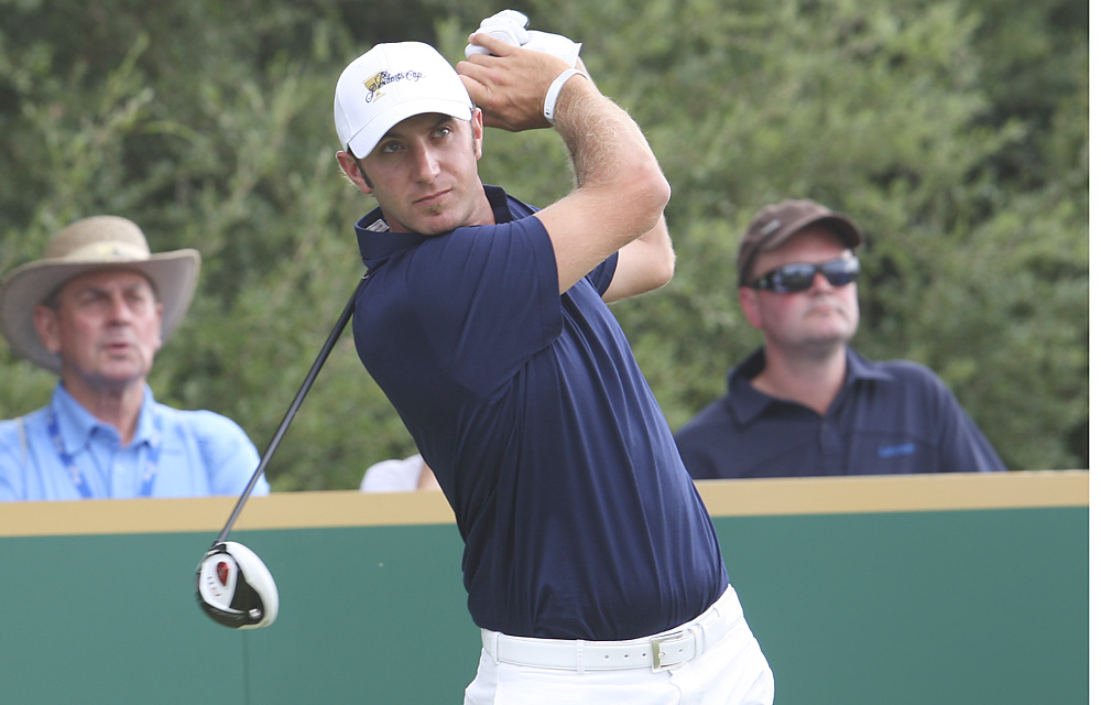 Dustin Johnson earned a point while teamed with Tiger Woods, but finished just 1-3-1.