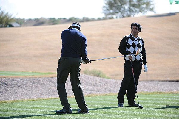 Earlier in the week, the scene in Scottsdale was not nearly as intense. Vijay Singh gave comedian George Lopez a few swing tips after Wednesday's Pro-Am at TPC Scottsdale.