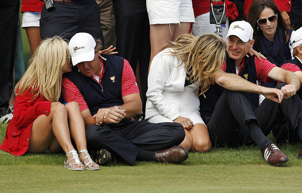 Phil Mickelson and Jim Furyk watched the end of Sunday's singles matches with their wives, Amy and Tabitha.