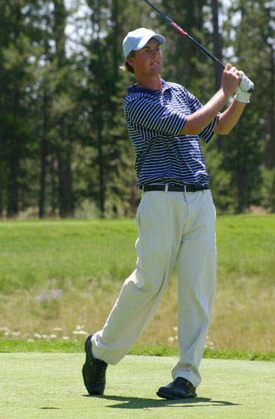 Webb Simpson follows his tee shot during an AJGA event.