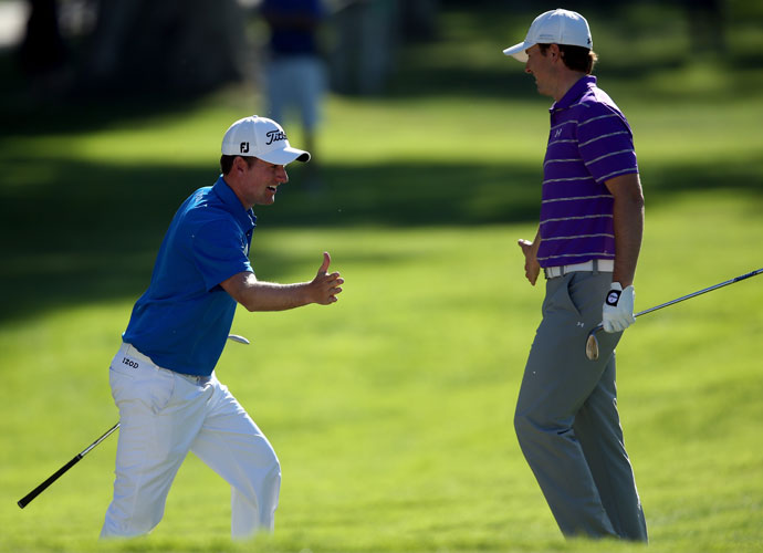 Webb Simpson (left) gets congratulated by Jordan Spieth after Simpson eagled the 11th hole in the first round. Simpson shot a 1-under 70 and was tied for 35th.