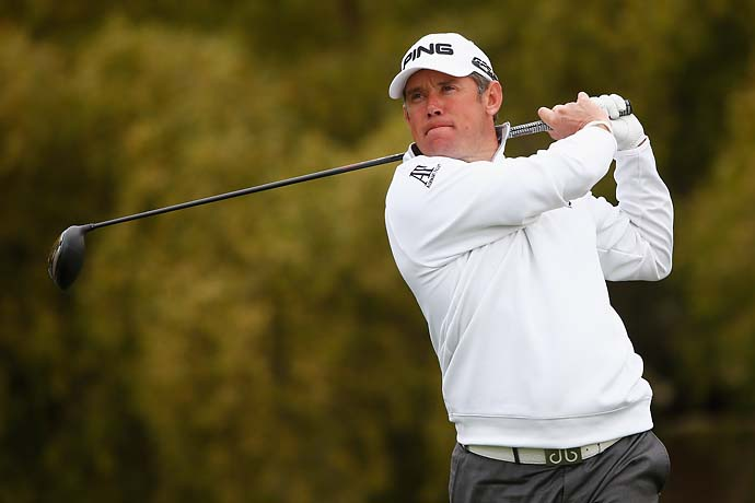 Lee Westwood played a shot through two tree trunks on the fifth hole.