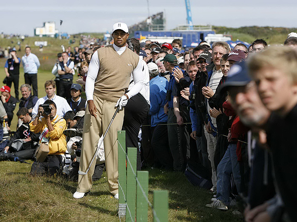 "Woods watched his second shot on the par-5 6th hole after a drive that went left and nearly out of bounds. In the first round, Woods made eagle on the hole, which is known as ""Hogan's Alley,"" but he settled for par on Friday."