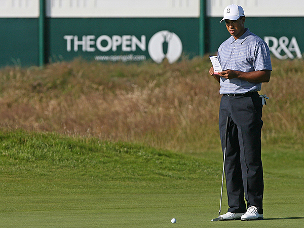 Tiger Woods studied Carnoustie's greens Tuesday morning. Woods has won the British Open three times, including the last two, but he ranks 118th on the PGA Tour in putts per round (29.47).
