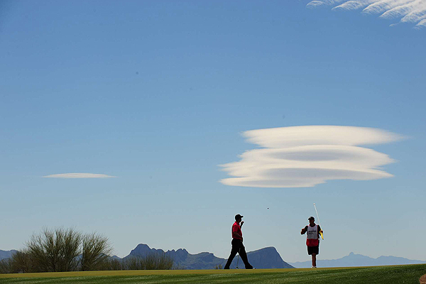 With unique clouds floating above the mountains, Steve Williams helped Woods stay in control of the match.