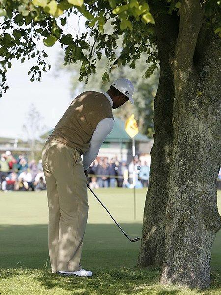 Woods's approach shot on the par-4 10th went right and landed in a stand of trees. He hit a delicate pitch that sailed inches from a tree, landed on the green and rolled to within a foot of the hole for a tap-in par.
