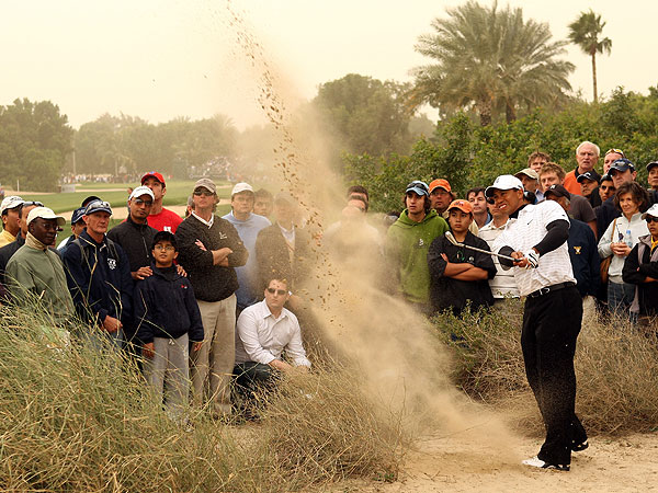 Woods found the sand off the tee on the par-5 13th hole.