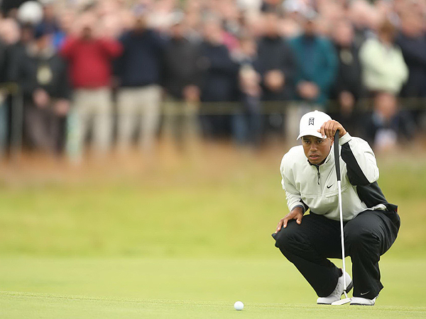 Tiger Woods hit 13 of 15 fairways Thursday but needed 30 putts to complete his opening round. The two-time defending champion finished the day two under par and in a tie for eighth place.