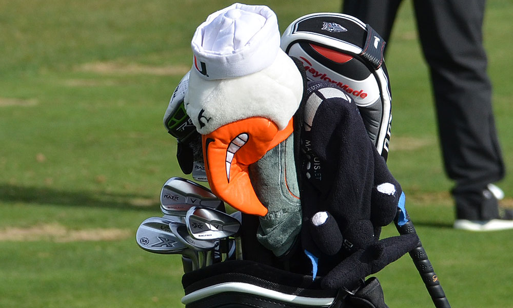 Austin's bag features Callaway RAZR X Muscleback irons and a University of Miami Ibis.