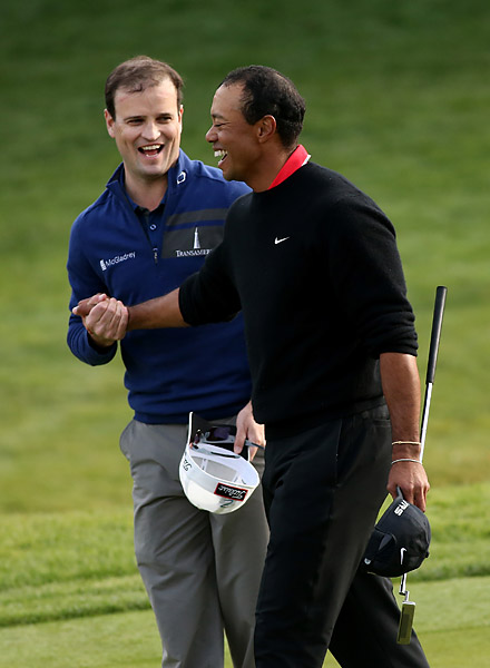 Zach Johnson and Tiger Woods both seemed relieved to still be playing after a wild 18th hole in which both golfers made unlikely par saves to force a playoff.
