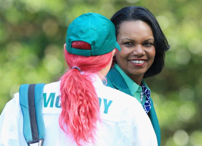 Caroline Wozniacki greets Condoleezza Rice.