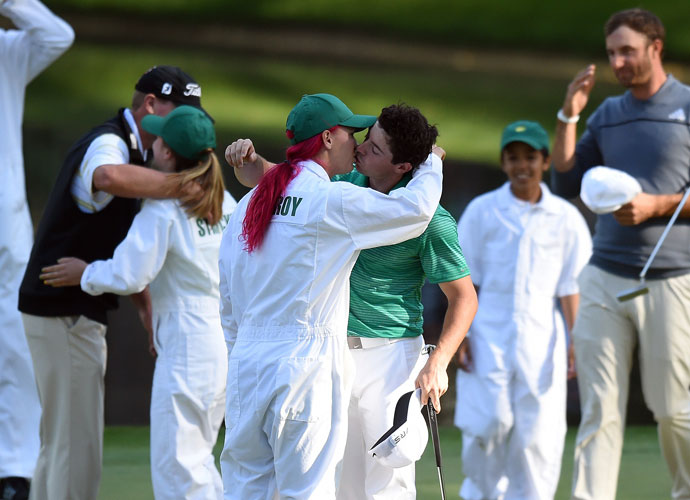 Rory McIlroy gets a kiss from Caroline Wozniacki at the end of the Par 3 Contest.