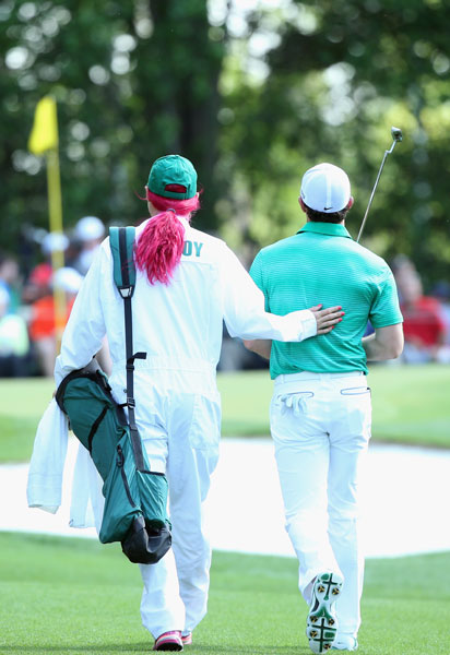 Caroline Wozniacki, who caddied for fiancé Rory McIlroy, opted for pink hair during the Par 3 Contest.
