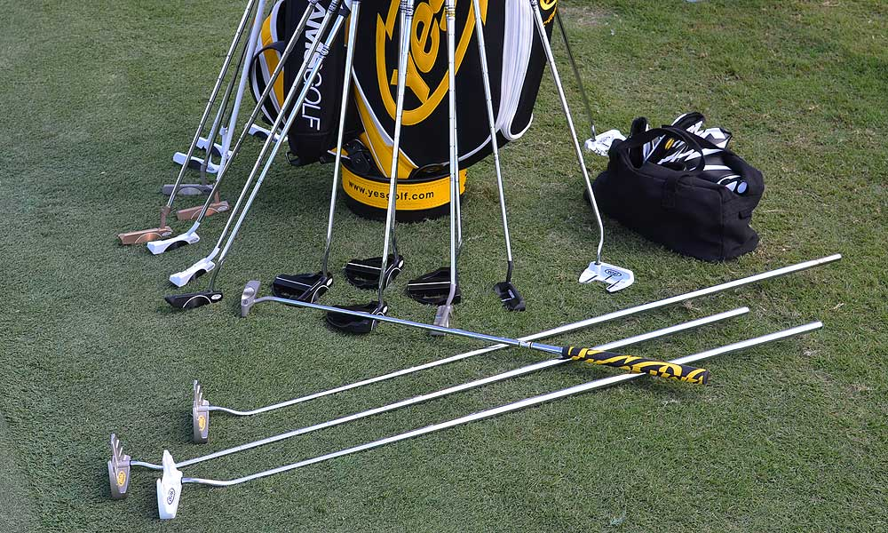 Lot of different Yes! putters were waiting to be tried on the practice green, including several extended-length models.