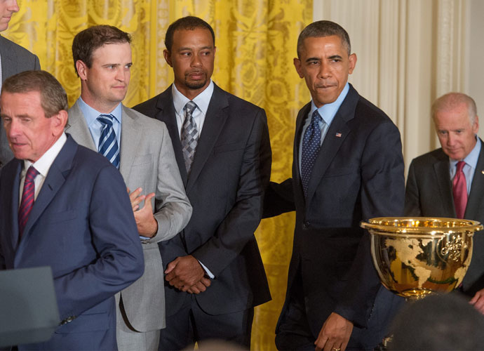 President Barack Obama enters the East Room at the White House alongside Zach Johnson, Tiger Woods and PGA Tour Commissioner Tim Finchem.