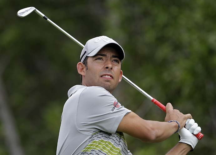 Pablo Larrazabal follows his ball on the 4th hole during the final round of the Abu Dhabi HSBC Golf Championship in Abu Dhabi, United Arab Emirates, Sunday Jan. 19, 2014.