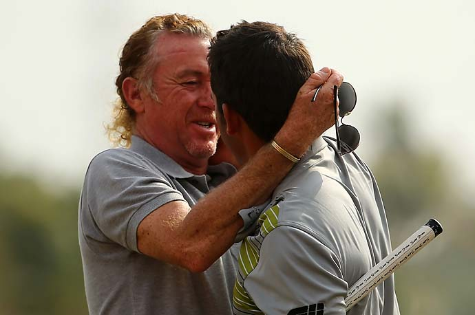 Pablo Larrazabal is congratulated by his countryman Miguel Angel Jimenez after winning the Abu Dhabi HSBC Golf Championship on January 19, 2014 in the United Arab Emirates' capital, Abu Dhabi.