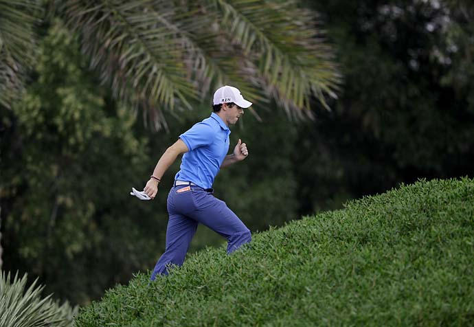 Rory McIlroy climbs up a hill to reach the 3rd hole during the final round of the Abu Dhabi HSBC Golf Championship in Abu Dhabi, United Arab Emirates, Sunday, Jan. 19, 2014.